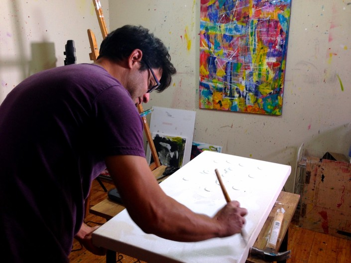 Hand priming a canvas with gesso is just one of the details that go into my work. Nestor Toro