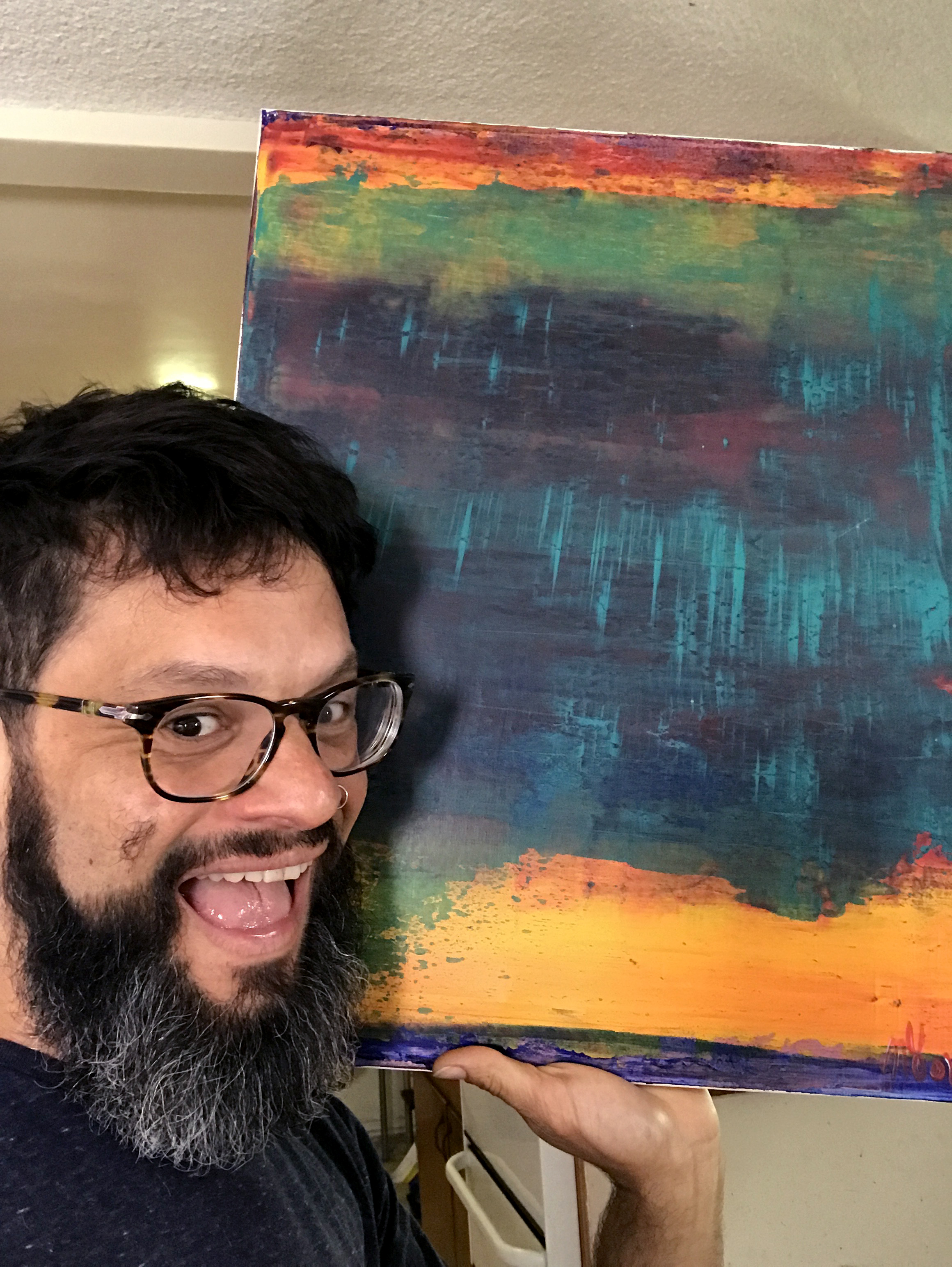 "Los Angeles abstract painter Nestor Toro with his work ""Perhaps a Sunset"""