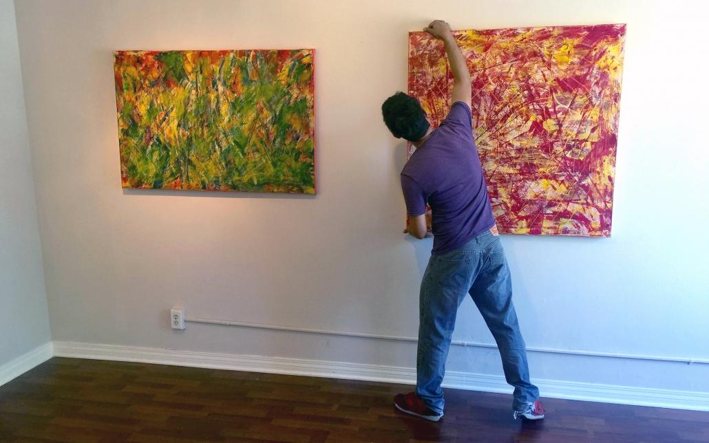 Artist Nestor Toro - Installing Artwork For Solo Show