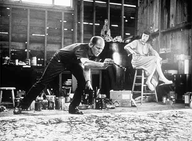 Jackson Pollock working in his studio with the canvas on the floor